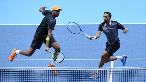 David Marrero y Tommy Robredo jugando al tenis